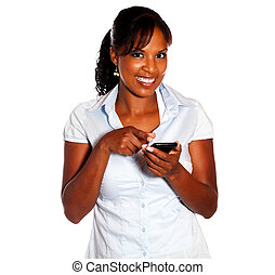 Afro-american female pointing her cellphone on isolated...