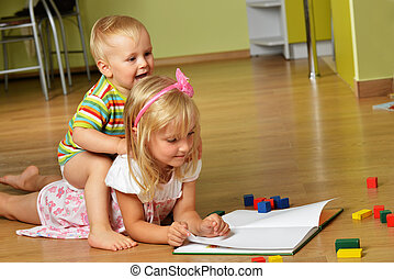 boy with his sister - little boy with his sister playing at...
