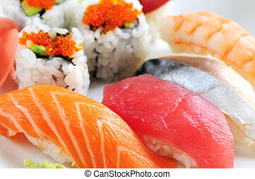 Sushi and california rolls on a plate macro