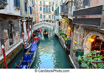 typical urban view with canal, boats and houses in Venice -...