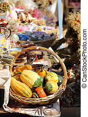 Big basket of vegetables and dried handmade flower bouquets...