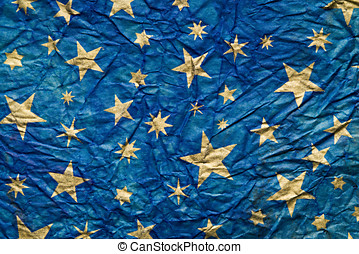 Stars wrinkled paper - Blu background with gold stars on a...