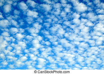 Pretty blue cloudscape with fluffy clouds - Pretty blue...