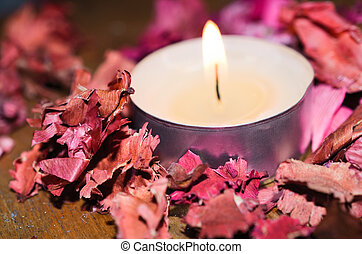 Candle with dry rose