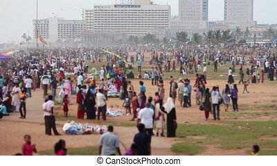 thousands of people at beach