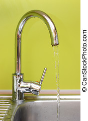 kitchen faucet and sink with running water