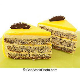 2 Slice of delicious mango cake with poppy on green plate