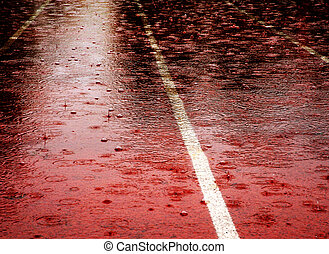 Race Rained Out - Race track filled with puddles on rainy...