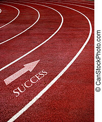 Exercise and Fitness - Lanes of a race track with a curve at...