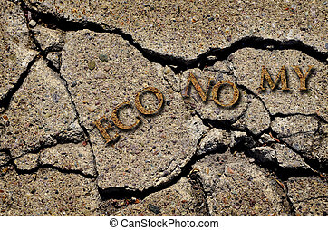 Broken or Cracked Economy - Crack in concrete symbolizing a...