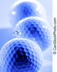 Golf Balls - Closeup of golfballs with dark shadows