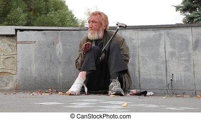 Beggar beg passers