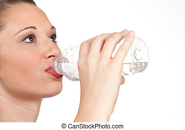 teen model closup of drinking water out of clear water bottle