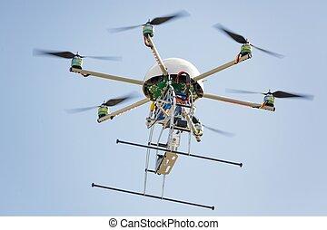 uav drone in sky - uav drone hexarotor flying in blue sky