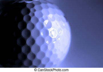 Golf Ball - Closeup of golfball with dark shadows