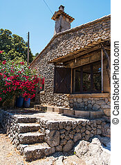 House wall and window with flowers in Mallorca
