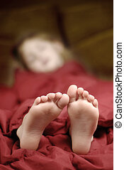 Sleeping Feet - Little girl sleeping with feet poking out of...