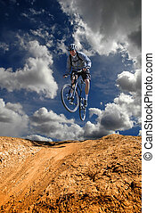 Mountain Biking - Man mountain biking on trail in outdoors