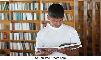 schoolboy in the library looking at the camera and smiling