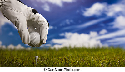 Golf - Hand and golf ball
