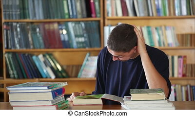 tired student in the library reading books 3