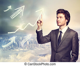 Businessman pointing rising arrows