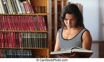 young girl in library looking at the camera and smiling 2
