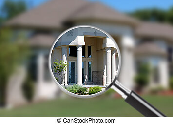 Focus on real estate - Magnifying glass focusing on part of...