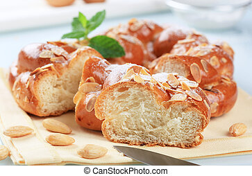 Sweet braided bread wreath topped with almonds