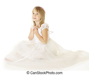 Beautiful Communion - A beautiful elementary girl sitting in...