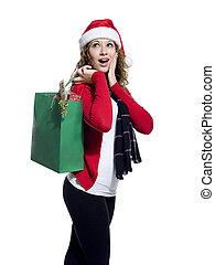 surprised young woman holding shopping bag