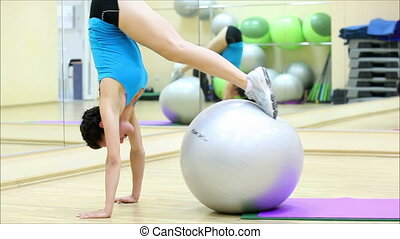 beautiful girl does exercises with the ball at the gym 1