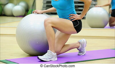 beautiful girl does exercises with the ball at the gym 7