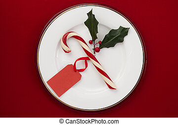candy cane with red tag in a plate - Image of candy cane...