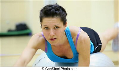 beautiful girl does exercises with the ball at the gym 10 -...
