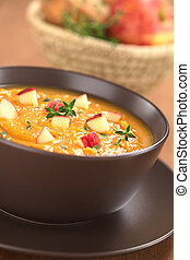Sweet Potato and Apple Soup - Bowl of fresh homemade sweet...