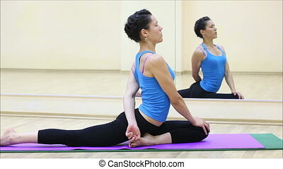 beautiful girl doing yoga in a gym 5 - beautiful girl doing...