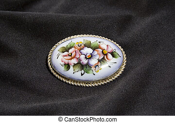 brooch - Cheap enamel brooch on black fabric