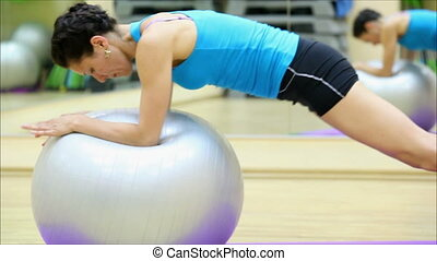beautiful girl does exercises with the ball at the gym 2 -...