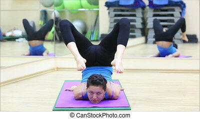 beautiful girl doing yoga in a gym 6