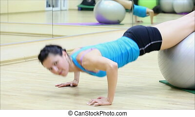 beautiful girl does exercises with the ball at the gym 9 -...