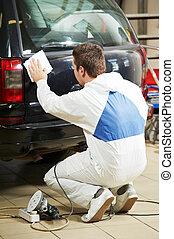 auto mechanic polishing car - auto mechanic worker preparing...