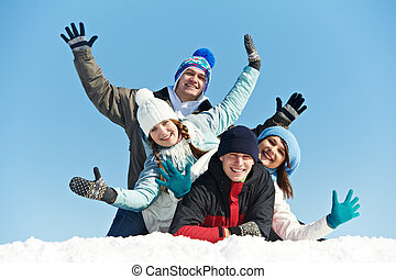 group of happy young people in winter - happy young smiling...