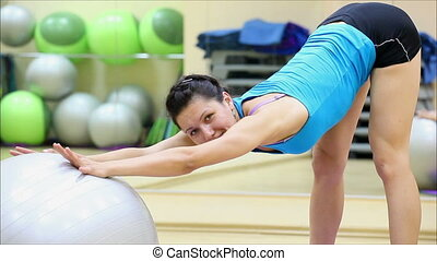 beautiful girl does exercises with the ball at the gym 8 -...