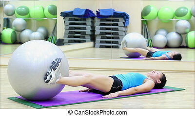 beautiful girl does exercises with the ball at the gym 6