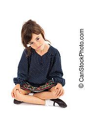 Little girl sitting with crossed legs - Full length portrait...
