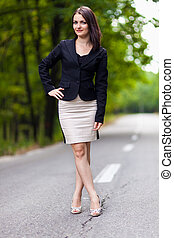Full length portrait of a young businesswoman standing on...