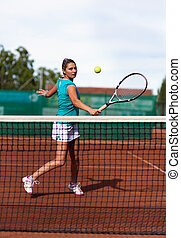 Beautiful woman tennis player prepared for backhand stroke -...