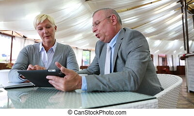 Best business solutions - Business people sitting at caf?...