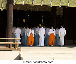 Shinto Temple Ritual Worship - A group of priests are lined...